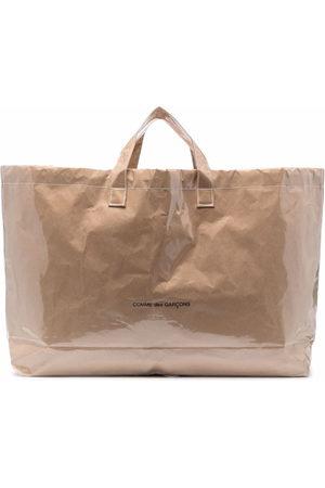 Comme des Garçons Logo print paper bag
