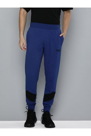 PUMA Men Navy Blue & Black Solid REBEL Joggers