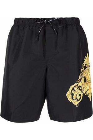 VERSACE Men Swim Shorts - Barocco-print swim shorts