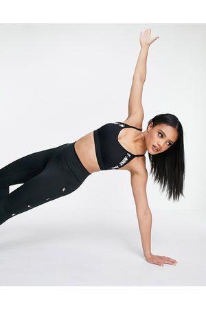 Nike Women Sports Bras - Indy light support logo taping sports bra in