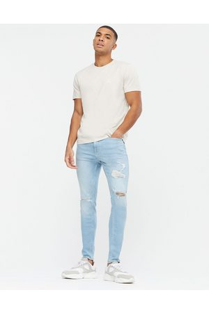 New Look Skinny jeans with extreme rips in light blue