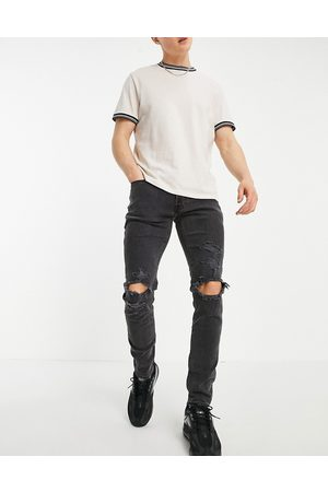 Abercrombie & Fitch Men Skinny - Super skinny distressed jeans in wash