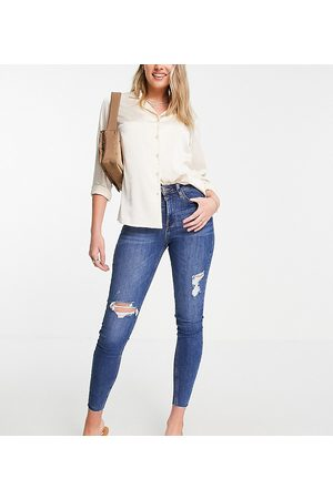River Island Ripped raw hem high rise skinny jeans in mid auth