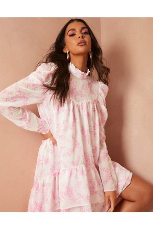 In The Style X Lorna Luxe graduated frill hem dress with full volume in pink floral print