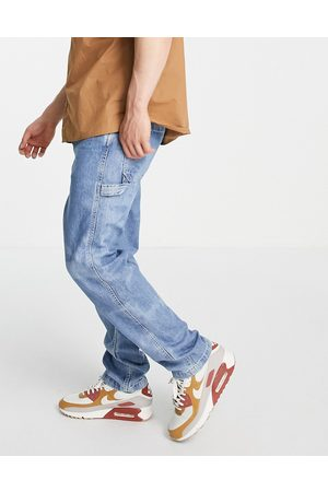 Levi's Levi's tapered fit carpenter jeans in mid wash
