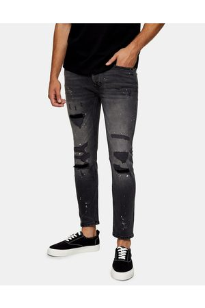 Topman Men Skinny - Organic cotton blend stretch skinny ripped and repaired paint jeans in washed