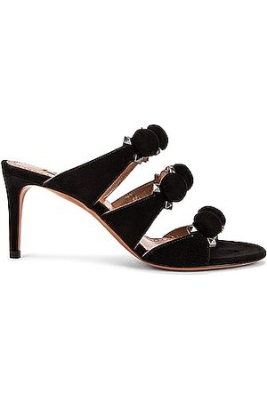 ALAÏA Pom Pom Studded Mules in Noir