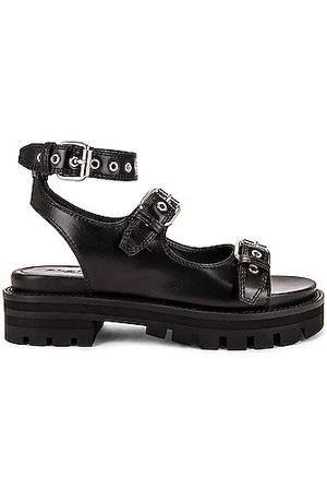 Alaïa Buckle Sandals in Noir