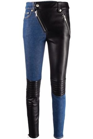 Moschino Contrasting-panel skinny trousers