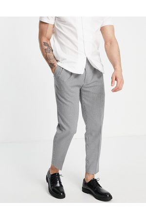 Topman Tapered checked trousers in