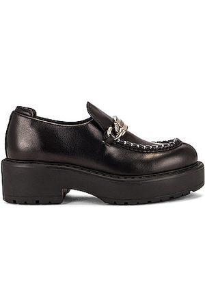 Miu Miu Leather Platform Loafers in Nero