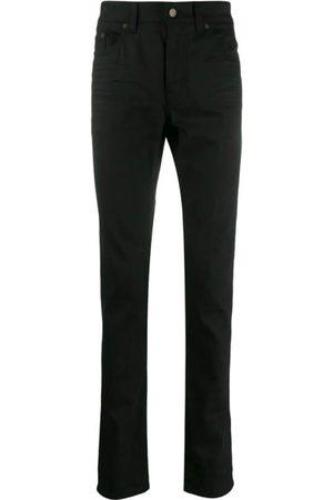 Saint Laurent Creased Skinny Jeans