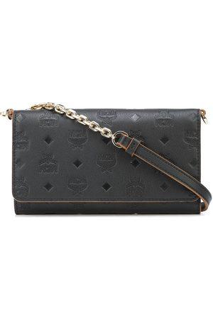 MCM Embossed-monogram chain-strap wallet