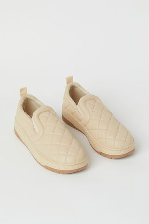 H & M Quilted slip-on trainers