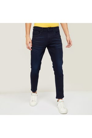 U.S. Polo Assn . Men Dark-Washed Slim Tapered Fit Jeans